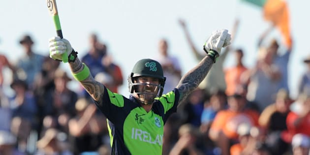 Ireland's John Mooney raises his arms after hitting the winning runs against West Indies during their Cricket World Cup pool B match at Nelson, New Zealand, Monday, Feb. 16, 2015. Ireland wins the match with 4 wickets and 25 balls to spare. (AP Photo/Ross Setford)