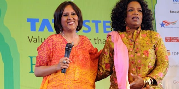 Television talk show host Oprah Winfrey (R) poses with Indian Journalist Barkha Dutt during the Jaipur Literature Festival (JLF) in Jaipur on January 22, 2012.  Television chatshow queen Oprah Winfrey received a rock star's welcome when she spoke on Sunday to a heaving audience of thousands of fans at the Jaipur Literature Festival in India. Winfrey, wearing a gold and red Indian outfit, told the packed crowd that her love of books had helped her education and enabled her to rise from a poor childhood in Mississippi to become one of the world's most influential women. AFP PHOTO / Prakash SINGH (Photo credit should read PRAKASH SINGH/AFP/Getty Images)
