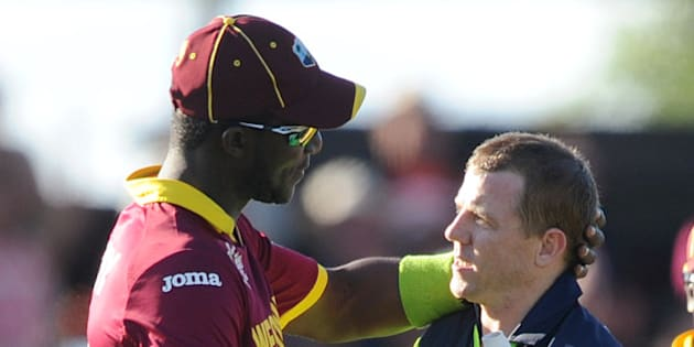 Ireland's Niall O'Brien, right, shakes hands with West Indies' Darren Sammy at the end of their Cricket World Cup pool B match at Nelson, New Zealand, Monday, Feb. 16, 2015. Ireland wins the match with 4 wickets and 25 balls to spare. (AP Photo/Ross Setford)