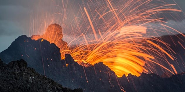 Lava erupts from the Piton de la Fournaise volcano Thursday, Feb.5, 2015 in the French Indian Ocean island of La Reunion. This is the second eruption in the past year at Piton de la Fournaise after 3-years of quiet. (AP Photo/Fabrice Wislez)