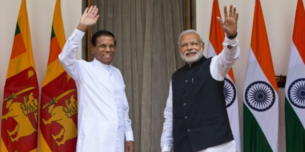 Sri Lanka's President Maithripala Sirisena, left, and Indian Prime Minister Narendra Modi wave during a photo opportunity in New Delhi, India, Monday, Feb. 16, 2015. Sri Lanka's new leader is underlining India's importance as a regional ally by making it his first official foreign destination as president, following years of uneasy relations with New Delhi and international pressure to speed up post-civil war reconciliation efforts at home.  (AP Photo/Saurabh Das)