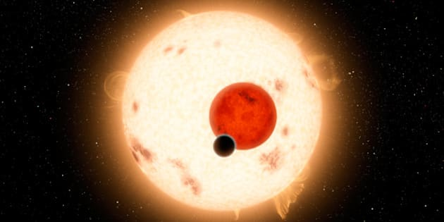 Artist's concept of the Kepler-16 system, showing the binary star being orbited by Kepler-16b. Kepler-16 orbits a slowly rotating K-dwarf that is very active with numerous star spots. Its other parent star is a small red dwarf. The planetary orbital plane is aligned within half a degree of the stellar binary orbital plane.
