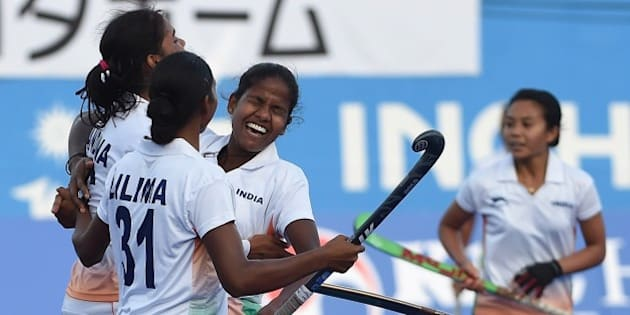 India's Vandana Kataria (L) celebrates a goal against Japan with Lilima Minz (2L) and teammates during their women's field hockey bronze medal match at the Seonhak Hockey Stadium during the 17th Asian Games in Incheon on October 1, 2014. AFP PHOTO / PRAKASH SINGH        (Photo credit should read PRAKASH SINGH/AFP/Getty Images)