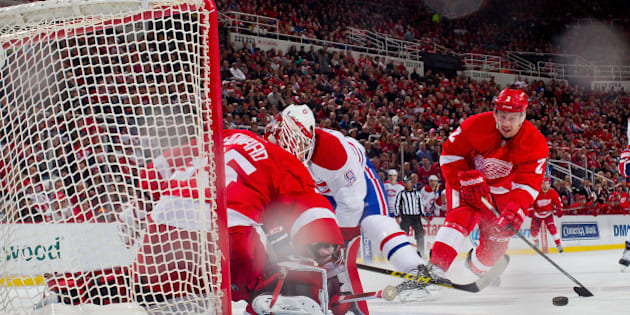 DETROIT, MI - FEBRUARY 16:  Goalie Jimmy Howard #35 of the Detroit Red Wings makes a save on Brandon Prust #8 of the Montreal Canadiens as teammate Brendan Smith #2 pressures him during a NHL game on February 16, 2015 at Joe Louis Arena in Detroit, Michigan. (Photo by Dave Reginek/NHLI via Getty Images)