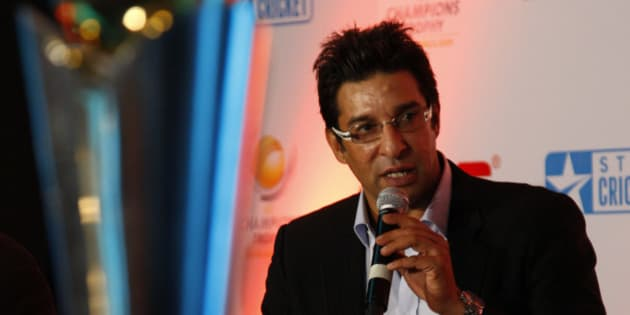 Former Pakistani cricketer Wasim Akram talks about the upcoming ICC Champions Trophy, in New Delhi, India, Thursday, Sept. 17, 2009. On the left is the trophy that will be handed out to the winner. (AP Photo/Saurabh Das)