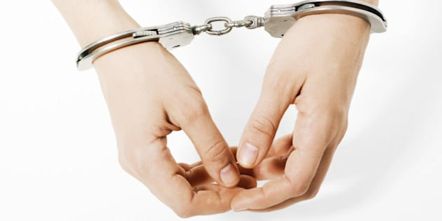 Handcuffed woman, close-up of hands
