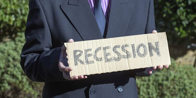 Man holding placard about recession