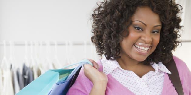 African American woman carrying shopping bag