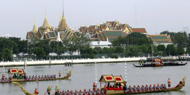 Ornate barges parade past the Grand Palace on the Chao Phraya River during rehearsal of Royal Barge Procession in Bangkok, Thailand, Friday, Nov. 2, 2012. The procession to make merit at a Thai Buddhist temple is scheduled for Nov. 9, 2012 after the Buddhist Lent has concluded. The procession was scheduled to take place last year but was delayed by the country's worst flooding in half a century. (AP Photo/Sakchai Lalit)