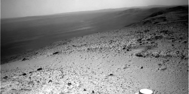 This image sent by NASA's Opportunity rover on Wednesday, Jan. 7, 2015 shows a view from atop a Martian hill. Opportunity will spend several days at the summit making pictures that engineers will stitch into a color panorama. (AP Photo/NASA)