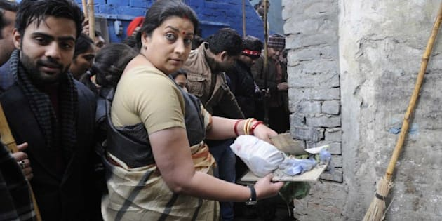 NEW DELHI, INDIA - JANUARY 8: Union Minister for Human Resource Development Smriti Irani participating in Swachh Bharat Abhiyan organized by ABVP & DUSU at Sanjay Basti, Timarpur on January 8, 2015 in New Delhi, India.  (Photo by Sushil Kumar/Hindustan Times via Getty Images)