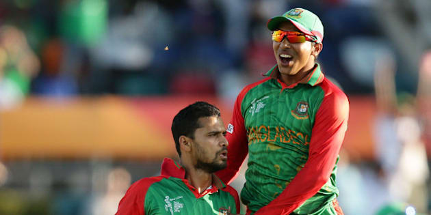 Bangladesh bowler Bin Mortaza Masrafe, left, is congratulated by teammate  Soumya Sarkar after dismissing Afghanistan batsman Afghanistan's Javed Ahmadi during their Cricket World Cup Pool A match in Canberra, Australia, Wednesday, Feb. 18, 2015. (AP Photo/Rob Griffith)