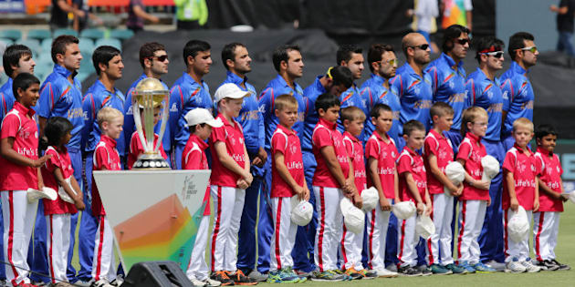 The Afghanistan team line up prior to the start of their Cricket World Cup Pool A match against Bangladesh in Canberra, Australia, Wednesday, Feb. 18, 2015. (AP Photo/Rob Griffith)