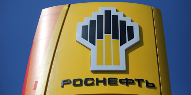 A logo sits on a sign outside an OAO Rosneft gas station in Moscow, Russia, on Friday, July 18, 2014. Russia's biggest oil company, natural gas producer OAO Novatek and OAO Gazprombank, the third-largest lender, are among those hit by the penalties, the U.S. Treasury Department said. Photographer: Andrey Rudakov/Bloomberg via Getty Images