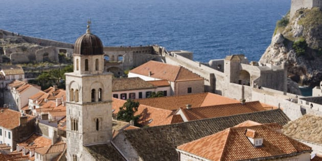 Croatia, Dubrovnik, Franciscan Monastry and rooftops by Adriatic Sea, elevated view