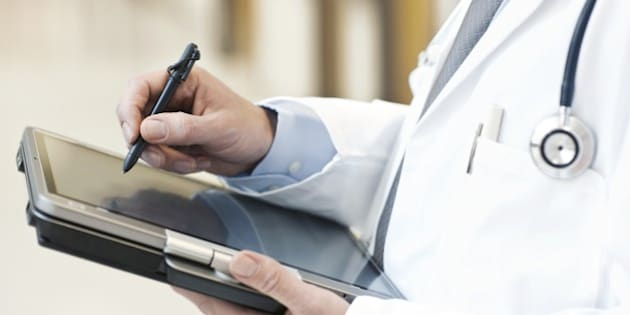 Doctor using a tablet PC.