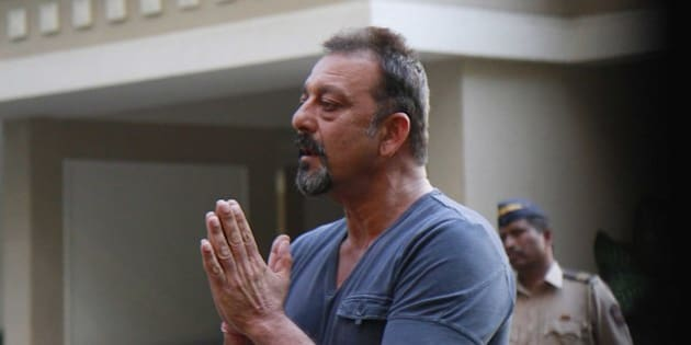 MUMBAI, INDIA - DECEMBER 21: Indian Bollywood actor Sanjay Dutt interacts with media after he was granted a month-long parole, the Bollywood actor was released from Pune's Yerwada Jail earlier on December 21, 2013 in Mumbai, India. Dutt, undergoing remainder of his five-year jail term for possessing illegal firearms, part of a cache of weapons meant to be used during the 1993 blasts, was granted parole on December 6. (Photo by Satish Bate/Hindustan Times via Getty Images)