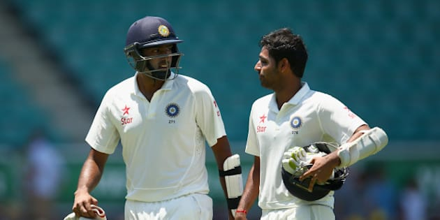 SYDNEY, AUSTRALIA - JANUARY 09:  Ravichandran Ashwin of India talks to team mate Bhuvneshwar Kumar during day four of the Fourth Test match between Australia and India at Sydney Cricket Ground on January 9, 2015 in Sydney, Australia.  (Photo by Cameron Spencer/Getty Images)