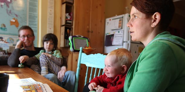 This May 7, 2011 photo shows parents Kathy Witterick, 38, right, and David Stocker, 39, left, as they sit with children Storm, second from right, and Jazz, second from left, in Toronto. Witterick, 38, and Stocker, 39, of Toronto, have chosen to keep the gender of Storm a secret. They have shared Storms's gender only with their sons Jazz, 5, and Kio, 2, a close family friend and two midwives who helped deliver the baby.   (AP Photo/THE CANADIAN PRESS/Toronto Star, Steve Russell)