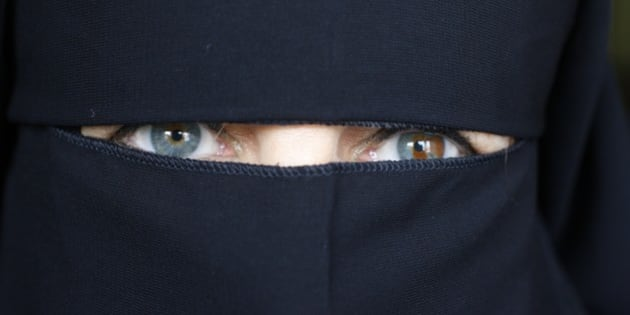 United Arab Emirates, Dubai, Woman wearing an abaya