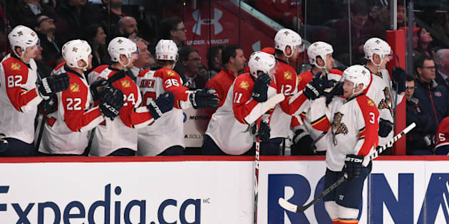 MONTREAL, QC - FEBRUARY 19: Steven Kampfer #3 of the Florida Panthers celebrates with the bench after scoring a goal against the Montreal Canadiens in the NHL game at the Bell Centre on February 19, 2015 in Montreal, Quebec, Canada. (Photo by Francois Lacasse/NHLI via Getty Images)