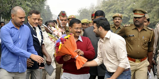 GHAZIABAD, INDIA - FEBRUARY 19: AAP leader and Delhi Chief Minister Arvind Kejriwal arrives for a meeting with public at his party office at Kaushambi area on February 19, 2015 in Ghaziabad, India. AAP said that Delhi Chief Minister Arvind Kejriwal would be holding public meetings or Janta Darbars between 10 AM to 11 AM on each Wednesday, Thursday and Friday. (Photo by Sakib Ali/Hindustan Times via Getty Images)