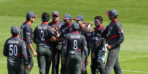 NELSON, NEW ZEALAND - FEBRUARY 19:  United Arab Emirates players celebrate  the wicket of Sikandar Raza of Zimbabwe during the 2015 ICC Cricket World Cup match between Zimbabwe and the United Arab Emirates at Saxton Field on February 19, 2015 in Nelson, New Zealand.  (Photo by Hagen Hopkins/Getty Images)