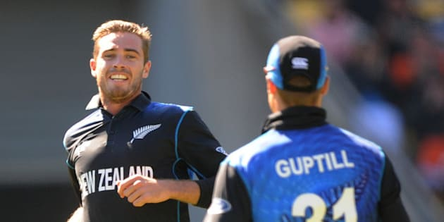New Zealand's Tim Southee left, celebrates with teammate Martin Guptill after dismissing England's Chris Woakes during their Cricket World Cup match in Wellington, New Zealand, Friday Feb. 20, 2015. (AP Photo/Ross Setford)