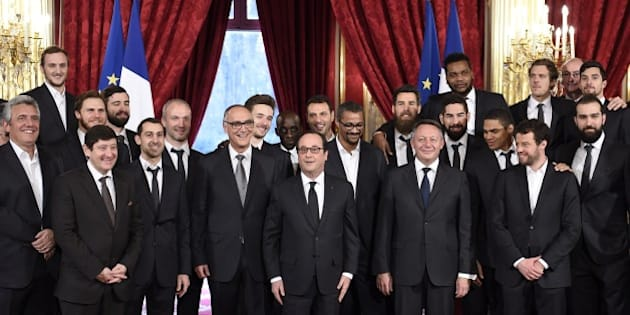 French President Francois Hollande (C) poses with French handball national team players and staff members on February 3, 2015 during a ceremony at the Elysee presidential palace in Paris to celebrate their world title. France won the 24th Men's Handball World Championships two days ago and became the first team in handball history to win five world championships when they beat surprise finalists Qatar 25-22. France are now world, European and Olympic champions, emphasising their current dominance of the sport.     AFP PHOTO / POOL / ERIC FEFERBERG        (Photo credit should read ERIC FEFERBERG/AFP/Getty Images)