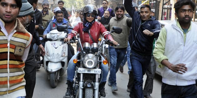 NEW DELHI, INDIA - JANUARY 29: Bollywood actress and AAP leader Gul Panag rides bike during election campaign for the party candidate at Shashtri Nagar area for the upcoming Delhi Assembly elections 2015 on January 29, 2015 in New Delhi, India. Polling in Delhi will be held on February 7 and the counting of votes will take place on February 10. (Photo by Subrata Biswas/Hindustan Times via Getty Images)