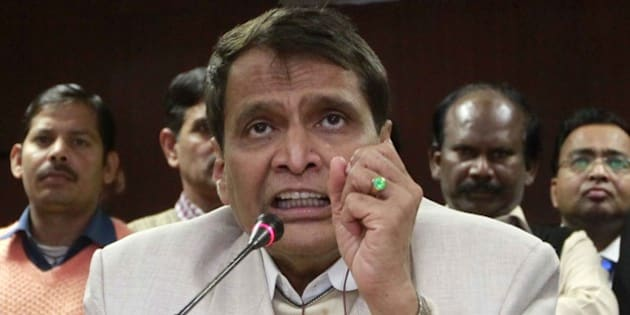 NEW DELHI, INDIA - FEBRUARY 9: Minister of Railways Suresh Prabhakar Prabhu during the flagging off eight new trains by remote control at Rail Bhawan, on February 9, 2015 in New Delhi, India.  Prabhu said railways are national asset and its functioning can be improved through cooperation from all. According to the railway ministry, these trains are part of the announcements made in the railway budget 2014-15. (Photo by Sanjeev Verma/Hindustan Times via Getty Images)