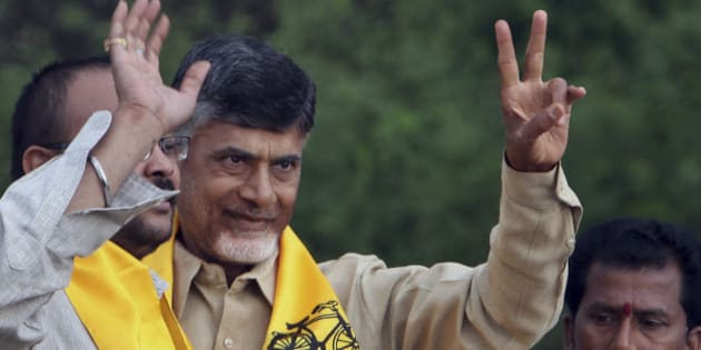 Telugu Desam Party (TDP) President and former Chief Minister of Andhra Pradesh state, N. Chandrababu Naidu, second left, greets his supporters during an election campaign rally in Hyderabad, India, Monday, April 14, 2014. The multiphase voting across the country runs until May 12, with results for the 543-seat lower house of parliament announced May 16. (AP Photo/Mahesh Kumar A.)