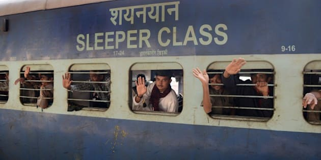 Indian fishermen, who were imprisoned in a Pakistani jail, wave as their train pulls out of the railway station in Ahmedabad on February 19, 2015.    Some 172 Indian fishermen arrived in the city after they were released from a Pakistani jail.  Fishermen are often arrested for violating the International Maritime Boundary Line (IMBL), mainly in the Arabian Sea, due to poorly-marked water boundaries and ill-equipped boats that lack the technology to specify exact locations.  AFP PHOTO / Sam PANTHAKY        (Photo credit should read SAM PANTHAKY/AFP/Getty Images)