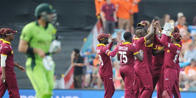 West Indies player's celebrate after dismissing Pakistan's captain Misbah Ul Haq, left, during their Cricket World Cup match in Christchurch, New Zealand, Saturday, Feb. 21, 2015. (AP Photo/Ross Setford)
