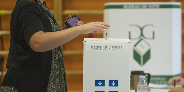 People vote on September 4, 2012 in l'Assomption, Quebec, Canada. Voting started Tuesday in a Quebec election expected to return separatists to power, buoyed by rising frustration with the current leadership and months of student protests over a planned tuition hike. Nearly six million voters in the country's only majority French-speaking province will choose 125 lawmakers. And pre-election polls point to the Parti Quebecois (PQ) coming out on top, though without a full majority. The PQ has been in the opposition since its 2003 defeat by the Liberals, led by Jean Charest, who is only the second person since the 1950s to have served three terms as Quebec premier.  AFP PHOTO / ROGERIO BARBOSA        (Photo credit should read ROGERIO BARBOSA/AFP/GettyImages)