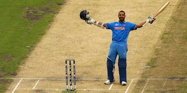 MELBOURNE, AUSTRALIA - FEBRUARY 22:  Shikhar Dhawan of India celebrates making a century during the 2015 ICC Cricket World Cup match between South Africa and India at Melbourne Cricket Ground on February 22, 2015 in Melbourne, Australia.  (Photo by Quinn Rooney/Getty Images)