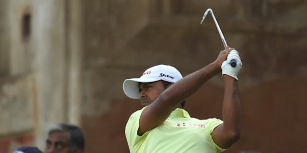 Indian golfer Anirban Lahiri plays a shot during the Indian Open golf tournament in New Delhi on February 22, 2015.  AFP PHOTO/ MONEY SHARMA        (Photo credit should read MONEY SHARMA/AFP/Getty Images)