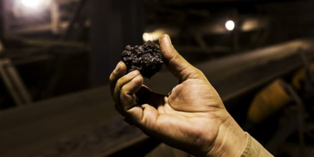 A worker holds a lump of sinter for a photograph in the sintering unit of the Jindal Steel & Power Ltd. plant in Raigarh, Chhattisgargh, India, on Monday, Feb. 9, 2015. Jindal Steel manufactures sponge iron, mild steel, and cement. The Company also produces power, conducts mining operations for iron ore and coal, and explores for natural gas and oil. Photographer: Udit Kulshrestha/Bloomberg via Getty Images