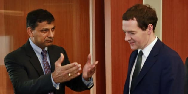 Reserve Bank of India (RBI) Governor Raghuram Rajan, left, and Britain's Chancellor of the Exchequer George Osborne arrive for a meeting at RBI headquarters in Mumbai, India, Monday, July 7, 2014. Osborne is on a two day official visit to India. (AP Photo/Rafiq Maqbool)