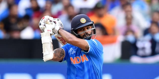 India's Shikhar Dhawan hits the ball to the boundary during their Cricket World Cup pool B match South Africa in Melbourne, Australia, Sunday, Feb. 22, 2015. (AP Photo/Theo Karanikos)