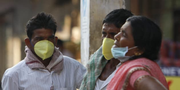 Indians cover their faces with masks as preventive measure against swine flu at the Gandhi Hospital in Hyderabad, in the southern Indian state of Telangana, Friday, Feb. 20, 2015. Health authorities were working to ensure remote hospitals in India had adequate medical supplies for a flu outbreak that has claimed more than 700 lives in 10 weeks. More than 11,000 cases have been reported since mid-December with most of the cases being reported from Rajasthan, Gujarat, Maharashtra, Telangana and Madhya Pradesh states. Although it was being referred to as swine flu, doctors say it is a variant of the H1N1 pandemic influenza. (AP Photo/Mahesh Kumar A.)