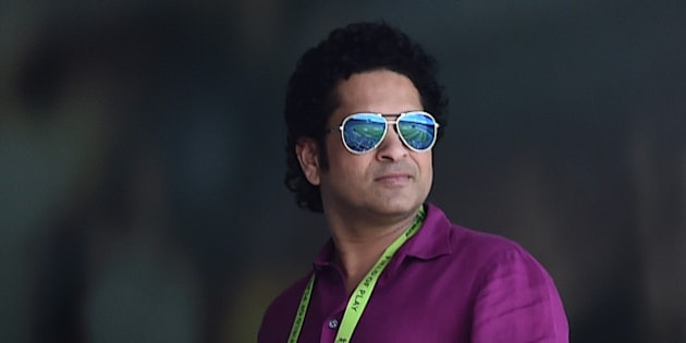 Former Indian cricketer Sachin Tendulkar watches the Cricket World Cup pool B match between India and South Africa at the Melbourne Cricket Ground in Melbourne, Australia, Sunday, Feb. 22, 2015. (AP Photo/Theo Karanikos)