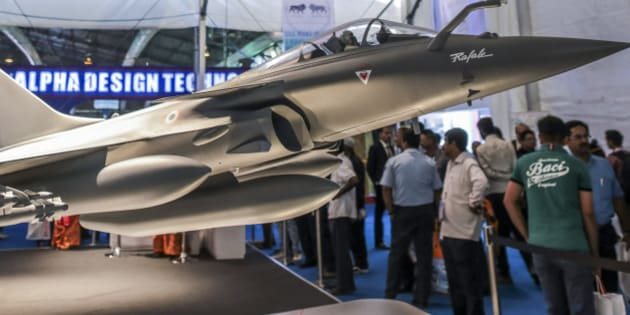 A model of Rafale multirole fighter aircraft, manufactured by Dassault Aviation SA., stands on display during the Aero India 2015 air show at Air Force Station Yelahanka, in Bengaluru, India, on Thursday, Feb 19, 2015. The bi-annual Aero India exhibit is the premier event for nations and companies to get a piece of the $150 billion that the world's biggest arms importer plans to spend on modernizing its military. Photographer: Dhiraj Singh