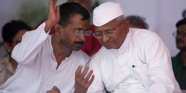 NEW DELHI, INDIA - AUGUST 03: Social activist Anna Hazare having a word with Arvind Kejriwal during their agitation against corruption at Jantar Mantar in New Delhi on Friday, 3rd August, 2012. (Photo by Parveen Negi/India Today Group/Getty Images)