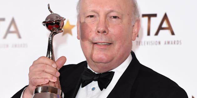 LONDON, ENGLAND - JANUARY 21:  Writer Julian Fellowes, winner of the Drama National Television award, poses in the winners room at the National Television Awards at 02 Arena on January 21, 2015 in London, England.  (Photo by Karwai Tang/WireImage)