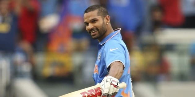 India's Shikhar Dhawan celebrates his hundred during their Cricket World Cup pool B match against South Africa in Melbourne, Australia, Sunday, Feb. 22, 2015. (AP Photo/Rick Rycroft)