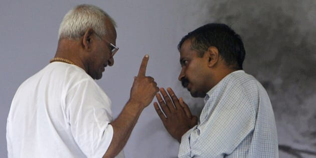 India's anti-corruption activist Anna Hazare, left, speaks with supporter Arvind Kejriwal on the 8th day of his hunger strike in New Delhi, India, Tuesday, Aug. 23, 2011. The government called Tuesday for India's political parties to reach consensus on drafting anti-corruption legislation, as an activist leading anti-graft protests entered the second week of his hunger strike. (AP Photo/Gurinder Osan)