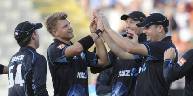 New Zealand's Corey Anderson, second from left, celebrates with teammates after dismissing India's Ajinkya Rahane for 3 in their third one day international cricket match at Eden Park in Auckland, New Zealand, Saturday, Jan. 25, 2014. (AP Photo/SNPA, Ross Setford) NEW ZEALAND OUT