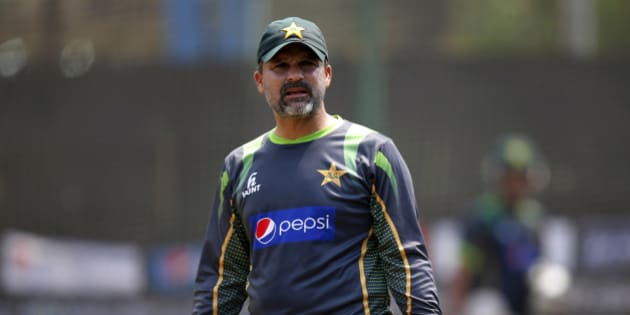 Pakistan cricket team coach Moin Khan gestures to players during a training session ahead of their ICC Twenty20 Cricket World Cup match against Australia in Dhaka, Bangladesh, Saturday, March 22, 2014. (AP Photo/Aijaz Rahi)