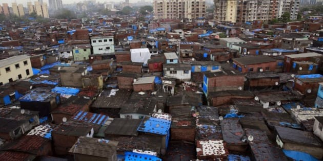 "High-rise buildings stand in the background over Dharavi, one of Asia's largest slums, in Mumbai, India, Thursday, July 10, 2014. India's new government introduced a reform-minded budget Thursday, vowing to lift economic growth to rates of 7-8 percent by promoting manufacturing and infrastructure and overhauling populist subsidies. Finance Minister Arun Jaitley outlined the broad strokes of the plan, which he said would be a departure from the ""mere populism and wasteful expenditure"" that has dragged down Asia's third-largest economy. (AP Photo/Rafiq Maqbool)"